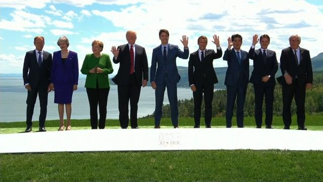 From left to right, Donald Tusk, Theresa May, Angela Merkel, Donald Trump, Justin Trudeau, Emmanuel Macron, Shinzo Abe, Giuseppe Conte and Jean-Claude Juncker pose for the a photo at the G7 Summit in Canada on June 8, 2018.
