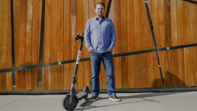 Travis VanderZanden, the founder of Bird, with one of the startup's electric scooters in Santa Monica, Calif., Feb. 14, 2018. Bird is reportedly raising $300 million in new funding that would value the company at $2 billion — financing that would cap one of the fastest and largest start-up fund-raising frenzies in recent memory. (Coley Brown/The New York Times)