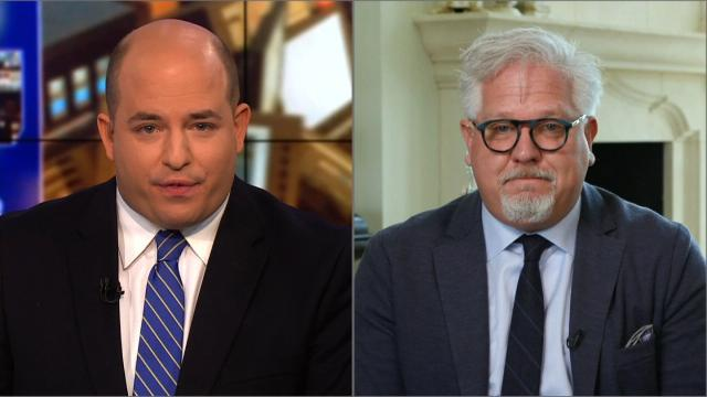 Glenn Beck walked out of a live interview on CNN when questioned about reported troubles at his media company.