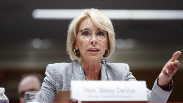 """FILE — Education Secretary Betsy DeVos testifies on Capitol Hill in Washington, June 5, 2018. Neurocore, a """"brain-performance"""" business which got more than $5 million from DeVos and her husband, has agreed to stop advertising success rates for treating attention deficit disorder, depression, autism and other maladies after a review found it could not support the claims. (Tom Brenner/The New York Times)"""