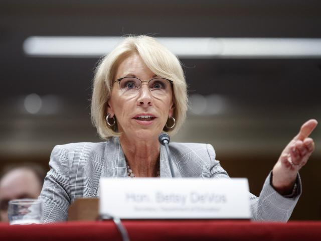 "FILE — Education Secretary Betsy DeVos testifies on Capitol Hill in Washington, June 5, 2018. Neurocore, a ""brain-performance"" business which got more than $5 million from DeVos and her husband, has agreed to stop advertising success rates for treating attention deficit disorder, depression, autism and other maladies after a review found it could not support the claims. (Tom Brenner/The New York Times)"