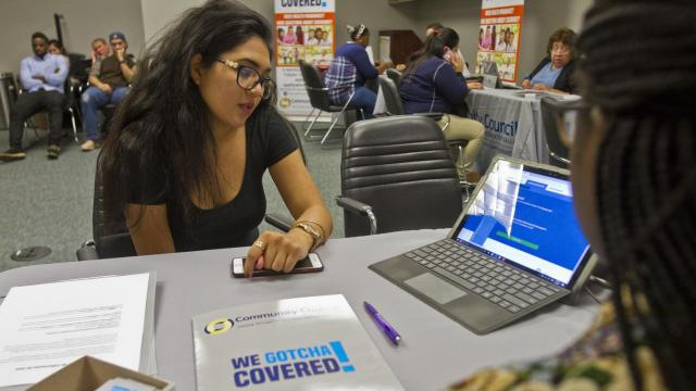 FILE-- Tiffany Collins, left, helps Okarinda Garcia sign up for health insurance under the Affordable Care Act, in Dallas, Jan. 30, 2017. In 2017, as insurance prices rose by an average of just over 20 percent around the country, people who qualified for Affordable Care Act subsidies hung onto their insurance. But according to a new government report, about a million people appear to have been priced out of the market for health insurance last year. (Mark Graham/The New York Times)