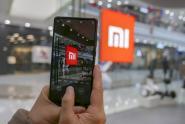 IMAGE: Xiaomi's IPO flop: Shares fall in Hong Kong debut