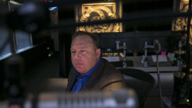 FILE — Alex Jones, conservative conspiracy theorist host of Infowars.com, in his Austin, Texas, control room, Feb. 17, 2017. In 2018, Apple, Facebook, YouTube and Spotify removed from their services large portions of content posted by Jones and his Infowars site, a major step by big technology firms to curb one of the most prominent online voices trafficking in misinformation. (Ilana Panich-Linsman/The New York Times)