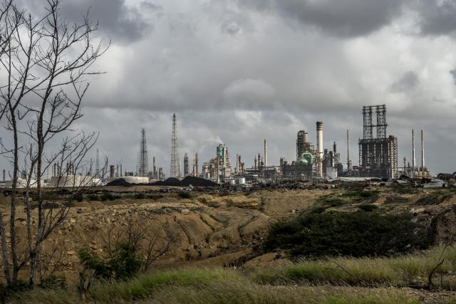 FILE -- The Amuay Refinery Complex, operated by Petroleos de Venezuela, in Los Taques, Venezuela, Dec. 7, 2017. Nearly bankrupt, the company agreed on Aug. 20 to pay a $2 billion judgment to compensate ConocoPhillips over the 2007 seizure of properties in Venezuela. (Meridith Kohut/The New York Times)