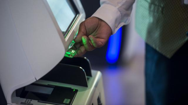 A boarding pass is printed at the remote check-in terminals at the Tampa International Airport in Tampa, Fla., Aug. 21, 2018. Last December, Tampa International entered into a two-year contract with Bags Inc. to check luggage remotely; officials say that through the end of August about 5 percent of all Tampa's bags were checked this way. (Zack Wittman/The New York Times)