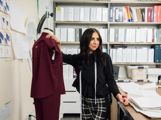 Allison Thielmann, an associate technical designer at Figs in Los Angeles, Sept. 24, 2018. As a girl, Thielmann developed a love of sewing. Now she designs scrubs for doctors, nurses and skin care specialists. (Jessica Chou/The New York Times)