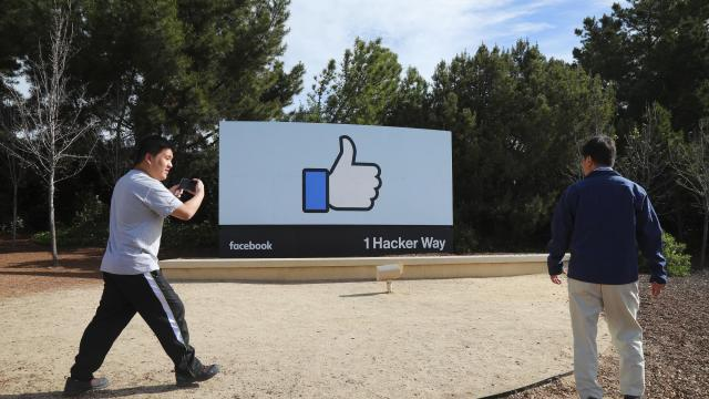 FILE -- Tourists at a sign on Facebook's campus in Menlo Park, Calif., April 10, 2018. The social media company said on Tuesday that its revenue rose 33 percent and profit increased 9 percent for the third quarter from a year earlier, roughly in line with what Wall Street had expected. (Jim Wilson/The New York Times)
