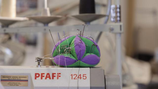 A pincushion at the offices of Leidos, a science and engineering company that has contracts with NASA, in Webster, Texas, Oct. 23, 2018. In 1975, Hue Nguyen, now a seamstress at Leidos, fled by boat from South Vietnam, where she had learned to sew. Now her finished work soars into space with NASA astronauts. (Todd Spoth/The New York Times)