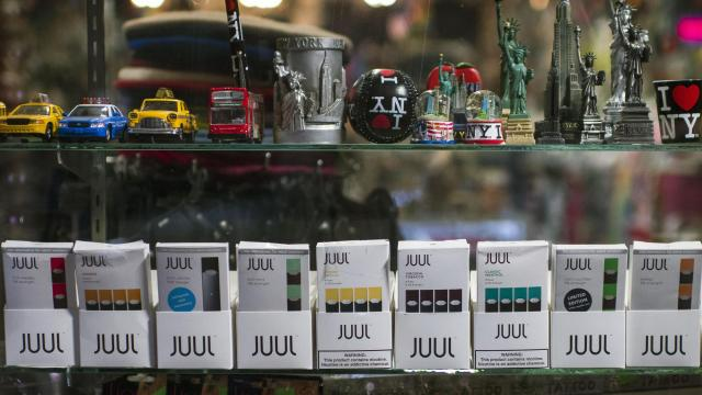 FILE -- Juul e-cigarettes are displayed for sale at a store in New York on Oct. 23, 2018. Facing mounting government pressure and a public backlash over the epidemic of teenage vaping, Juul Labs announced on Tuesday, Nov. 13, 2018, that it would stop selling most of its flavored e-cigarette pods in retail stores and would discontinue its social media promotions. (Joshua Bright/The New York Times)