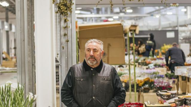 """Dennis Edwards, a flower wholesaler, at the New Covent Garden Market in London, Oct. 28, 2018. From greenhouses in Kenya to Dutch distributors to florists across England, the global flower trade highlights Brexit's potential disruption to commerce. """"The Dutch still want to serve us, and we still want to buy their product. But nobody knows what will happen,"""" he said. (Andrew Urwin/The New York Times)"""