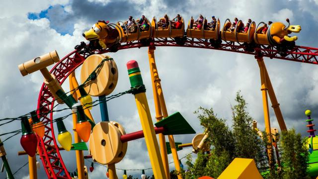 "Guests ride a new rollercoaster at the ""Toy Story Land"" attraction at Disney World in Orlando, Fla., June 30, 2018. With its television business facing significant challenges in the streaming age, and lots of popular movie franchises to put to use, Disney is spending billions to supercharge its theme park division, which has emerged as a surprisingly strong moneymaker. (Scott McIntyre/The New York Times)"