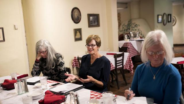 """Eve Lewis, 64, at a meeting of the Evergreen investment club, in Cincinnati, Oct. 22, 2018. Taking more responsibility for financial well-being early on can benefit women who must manage money alone after the death of a spouse; Lewis lost her husband to cancer in 2008. """"I figured, I have more time now, I'd better join a club,"""" she said. (Maddie McGarvey/The New York Times)"""