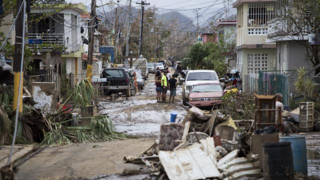 FILE — Debris and mud left by flooding after Hurricane Maria in Toa Baja, Puerto Rico, Sept. 22, 2017. Even in low-risk areas, mortgage companies and insurers may require homeowners to buy a flood insurance policy or face an even more expensive option: force-placed insurance, which the mortgage holder purchases and charges to the homeowner. (Erika P. Rodriguez/The New York Times)