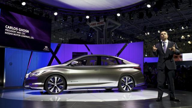 FILE-- Carlos Ghosn, president and chief executive of Nissan, with the Infiniti LE concept at the New York International Auto Show in the Javits Convention Center, in New York, April 5, 2012. Ghosn was arrested on Nov. 19, 2018, after an internal company investigation found that he had underreported his compensation to the Japanese financial authorities for several years. Nissan said it was cooperating with Japanese prosecutors. Both Ghosn and a director, Greg Kelly, who was also accused of misconduct, were taken in by authorities, the company said. (Benjamin Norman/The New York Times)