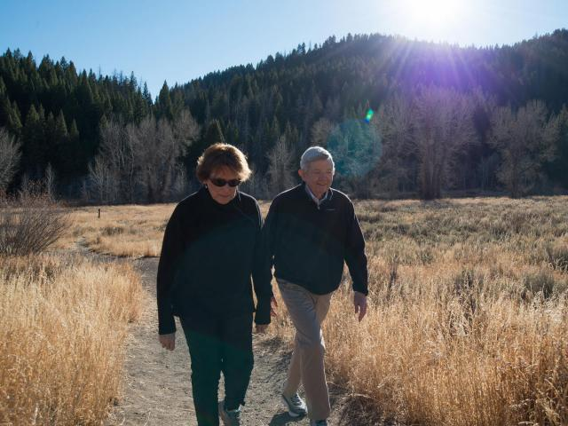 Jeannie and Rod Koleno, a retired couple, hike Lane's Trail near Adams Gulch in Idaho, Nov. 11, 2018. Many people looking to retire assume that they can spend 4 percent of their savings each year and that expenses will stay stable. Some research shows a decline instead. (Alex Hecht/The New York Times)
