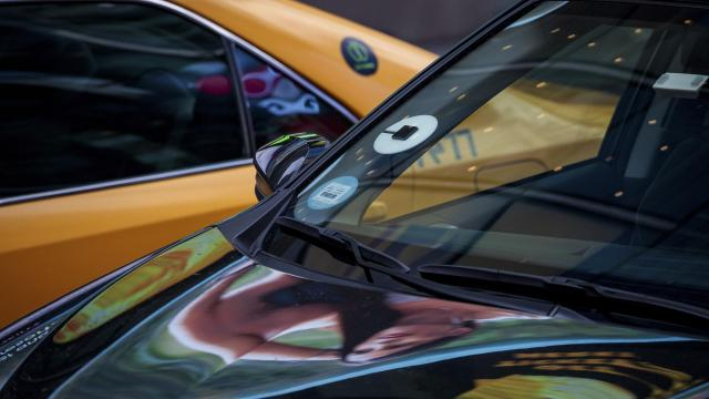 FILE -- An Uber car and a taxi during rush hour traffic in Times Square in New York, Aug. 1, 2018. Uber Technologies has confidentially filed paperwork with the Securities and Exchange Commission for an initial public offering this week, according to two people familiar with the matter. The offering, which is expected to be a hotly anticipated debut, puts the ride-hailing service neck and neck with its rival Lyft in a race to the public markets. (Damon Winter/The New York Times)