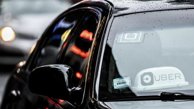 Uber signage inside of a ride-hailing car in Manhattan, April 14, 2019. Uber plans to set a price range for its initial public offering that would value it at as much as $90 billion, said a person with knowledge of the situation, in a sign of caution amid a flood of highly hyped tech offerings. (Jeenah Moon/The New York Times)