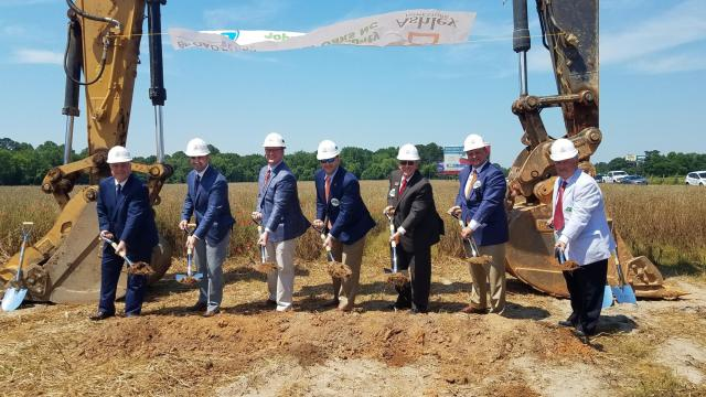 Officials break ground on a furniture distributon center planned in Four Oaks on May 28, 2019. (Photo courtesy of Johnston County Economic Development Office)