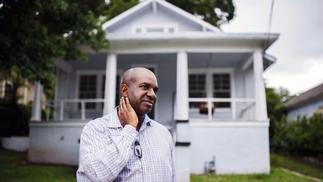 Real estate agent Derrick Duckworth outside a home that he is fixing in order to flip in Atlanta on June 12, 2019. Investors, fueled by Wall Street capital, are buying up many homes to resell at a profit, which has led to a scarcity of affordably priced housing in many big cities. (Melissa Golden/The New York Times}