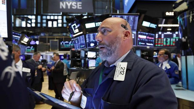 Dow opens lower as earnings bonanza continues