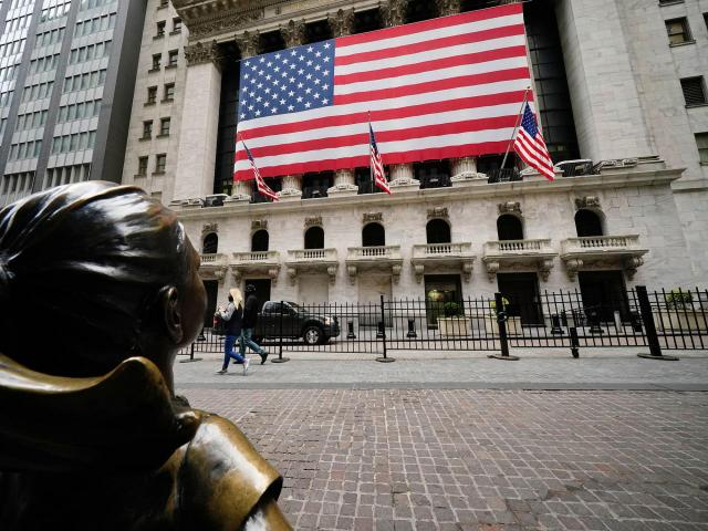 Asian markets, US stock futures mixed after tepid Tuesday on Wall Street