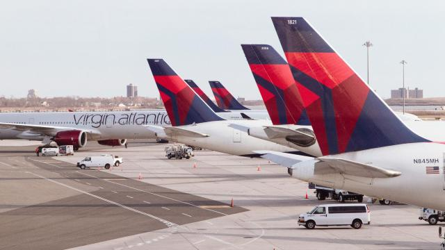 FILE -- Delta airplanes at John F. Kennedy International Airport in New York, Thursday, March 5, 2020. Delta Air Lines and other major carriers have announced status extensions into 2022. Major airlines and hotels don't want to lose their highest-spending customers, so they are giving them an extra year to accumulate the points that result in free upgrades, breakfasts, club access and other perks. (Landon Speers/The New York Times).