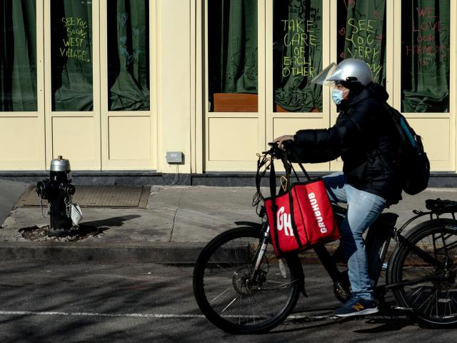FILE -- A delivery rider for Grubhub in the Greenwich VIllage neighborhood of New York on April 19, 2020. Uber is in talks to acquire the food delivery company. (Erin Schaff/The New York Times)