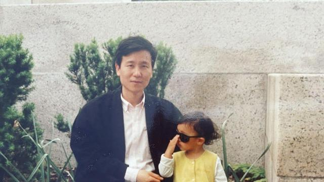 In an undated photo provided by Sandra Na, Yong Sup Na with his daughter Jenny in 1994. His first store once belonged to a white man who wanted to move out of a diversifying neighborhood. (Sandra Na via The New York Times) -- NO SALES; FOR EDITORIAL USE ONLY WITH NYT STORY CHICAGO RETAILER RACE ADV18 BY MICHAEL CORKERY FOR OCT. 18, 2020. ALL OTHER USE PROHIBITED. --.