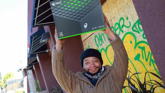 Brian Kinney holds a new Xbox at a GameStop in Emeryville, Calif., Nov. 10, 2020. The video game industry has notched record spending and profit in 2020, but to sustain its growth, it must prepare to compete with the return of concerts, movie theaters and live sports. (Jim Wilson/The New York Times)