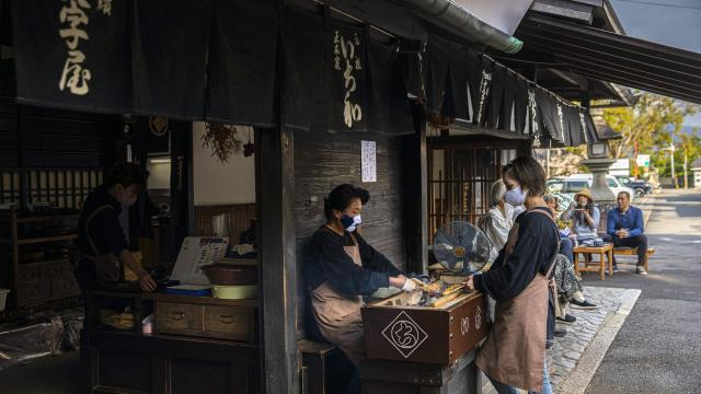 Ichiwa, which has been selling grilled rice flour cakes to travelers for a thousand years, in Kyoto, Japan, Oct. 23, 2020. The mochi seller, and many of Japan's other centuries-old businesses, have endured by putting tradition and stability over profit and growth. (Hiroko Masuike/The New York Times)