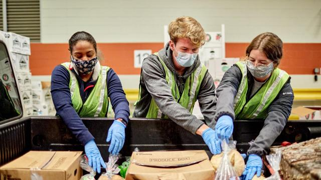 FILE -- A group of volunteers hand off food donations in Indianapolis on Wednesday, Jan. 6, 2021. More than one million people filed for unemployment benefits last week. (Stephen Speranza/The New York Times)