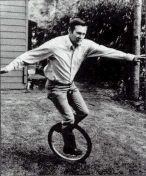 Donald Rumsfeld rides a unicycle.  (Unicyclist.org)
