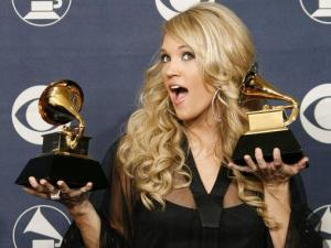 "Carrie Underwood poses with the awards for best new artist and for best female country vocal performance for ""Jesus, Take the Wheel"" at the 49th Annual Grammy Awards in Los Angeles on, Feb. 11. (AP Photo/Kevork Djansezian)"