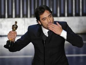 "Spanish actor Javier Bardem accepts the Oscar for best supporting actor for his work in ""No Country for Old Men"" at the 80th Academy Awards Sunday, Feb. 24, 2008, in Los Angeles. (AP Photo/Mark J. Terrill)"