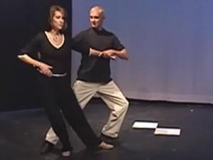 "WRAL-TV news anchor Lynda Loveland practices with her professional dance instructor, Dick Hensley, for the April 27 competition ""Dancing Like the Stars."""
