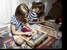 Olivia Parker and Anais Jaoui learning to make Turkish rugs.