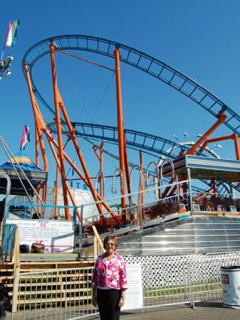 N.C. Labor Commissioner Cherie Berry poses in front of the RC-48 roller coaster at the N.C. State Fair on Oct. 16, 2008. A contest to name the coaster would take place later that day.