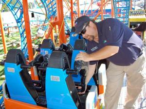 N.C. Department of Labor inspector Harold Wagner inspects the RC-48 roller coaster at the N.C. State Fair on Oct. 16, 2008. Wagner is checking the seat restraints to make sure they lock.