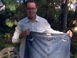 Subway spokesman Jared Fogle holds the 60-inch waist jeans he used to wear before losing more than 200 pounds. Fogle attended the N.C. State Fair on Oct. 22, 2008 to attend the Pants Dance Revolution event.