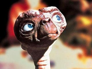 E.T. probably feeling bad that he made me cry all those years ago. (Image from Yahoo.com)