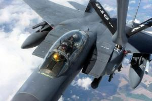 An F-15E Strike Eagle gets fuel from a KC-135 Stratotanker at 20,000 ft above North Carolina's coastal region. (Photo by Gray Whitley)