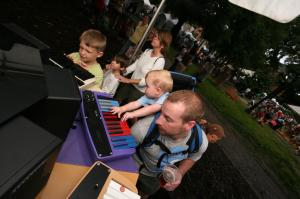 This father and son team try out this music making demonstration.