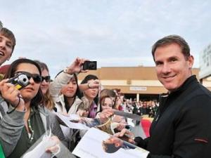"""Author of """"Dear John"""" Nicholas Sparks signs autographs prior to a screening of the film at Fort Bragg in Fayetteville, Saturday, Jan. 23, 2010. (Photo courtesy of Pouya Dianat/Allied Integrated Marketing/Copyright Carolyn Sloss)"""