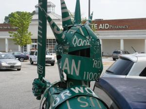 "North Carolina State University student Joe Carnevale's new sculpture, ""Street Knight,"" was installed in Cameron Village Saturday as part of its Earth Day celebrations. The 15-foot-tall knight is made completely of street signs. (Photo courtesy of Pat Hunnell/Public Relations Counsel)"