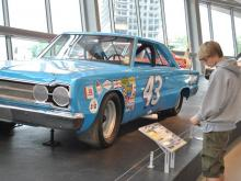 The 150,000-square-foot NASCAR Hall of Fame is a shrine of memorabilia and exhibits that recreate old-time NASCAR lore.