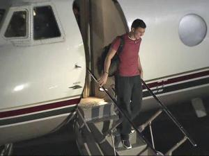 Scotty McCreery arrives at RDU May 13, 2011.