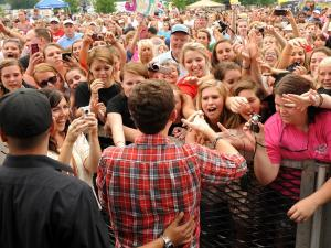 American Idol contestant Scotty McCreery reached out to fans for handshakes, hugs and autographs after a concert Saturday in Raleigh.