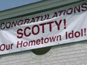 "This sign hung outside the business where Scotty McCreery's mother works on Thursday, May 25, 2011, the day after the 17-year-old Garner native won ""American Idol."""