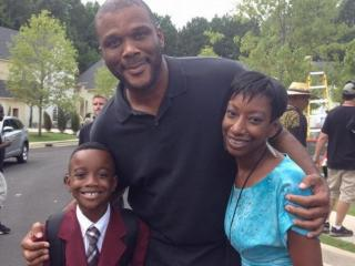 "Raleigh's Timmy Richardson and his mother pose for a photo with Tyler Perry. Richardson is appearing on Perry's new OWN series ""If Loving You Is Wrong."" (Image from Facebook)"